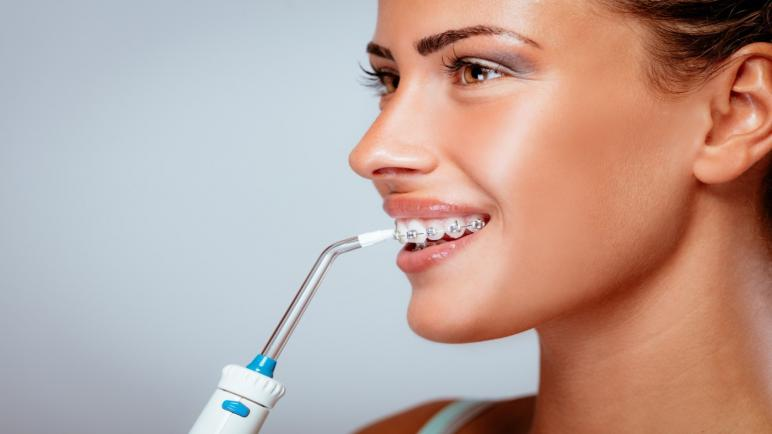 أفضل أنواع جهاز تنظيف الأسنان بالماء من الجير
